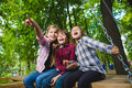 Smiling Kids Having Fun At Playground. Children Playing Outdoors In Summer. Teenagers Riding On A Swing Outside Stock Photo - 74558010