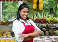 Laughing Mexican Saleswoman With Tropical Fruits On Farmers Market Stock Images - 74564544