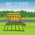 Yellow School Bus Driving Along Country Road. Royalty Free Stock Image - 74584616