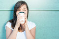 Attractive Girl Holding Coffee And Drinking And Enjoying Royalty Free Stock Images - 74591489