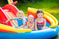 Kids Playing In Inflatable Swimming Pool Royalty Free Stock Image - 74612976