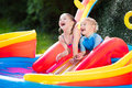 Kids Playing In Inflatable Swimming Pool Stock Image - 74613021