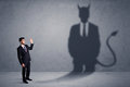 Business Man Looking At His Own Devil Demon Shadow Concept Stock Photography - 74614132