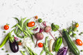 Food Background. Assortment Of Fresh Vegetables On A Light Background - Zucchini, Eggplant, Peppers, Beets, Tomatoes, Green Beans, Stock Images - 74626394