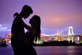 Silhouette Romantic Lovers With Odaiba Royalty Free Stock Image - 74668826