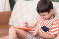 Little Boy Play Game Tablet With Angry Feeling Stock Photography - 74682052