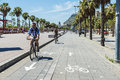 People Walk On The Promenade In Barcelona Royalty Free Stock Photography - 74688687