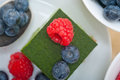Green Tea Matcha Mousse Cake With Berries Stock Images - 74710264