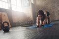 Focused Woman Stretching On Fitness Mat Royalty Free Stock Photos - 74733358