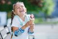 Cheerful Little Girl In The Park With Ice Cream Cone Royalty Free Stock Photos - 74748308