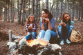 Children By The Fire In Autumn Forest Royalty Free Stock Photo - 74750025