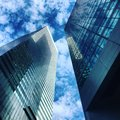 Skyscraper Business Buildings In Blue Sky With Clouds. Royalty Free Stock Image - 74766136