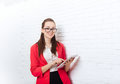 Businesswoman Use Tablet Computer Touch Screen Wear Red Jacket Glasses Happy Smile Stock Photo - 74778610