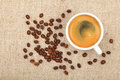 Full Espresso Cup And Coffee Beans On Canvas Royalty Free Stock Photos - 74795528