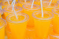Orange Juice In Clear Cups With Straws Stock Photography - 74797782