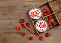 Two Glasses Of Yogurt,Red Fresh Strawberries In The Rattan Box With Plastic Spoons On The Wooden Table.Breakfast Organic Healthy T Stock Images - 74809094