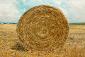 Hay Bale In The Foreground Royalty Free Stock Images - 74830989