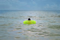 Boy Floating In Waves At Seashore Stock Photography - 74837882