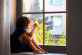 Sad Child, Boy, Sitting On A Window Shield Royalty Free Stock Photo - 74854775