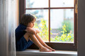Sad Child, Boy, Sitting On A Window Shield Royalty Free Stock Photo - 74854785
