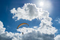 Hang Glider Riding Upwards To Reach Clouds Under The Sun Royalty Free Stock Photo - 74865045