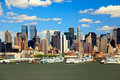 The Mid-town Manhattan Skyline On A Sunny Day Royalty Free Stock Photography - 7494807
