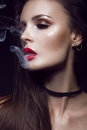 Beautiful Sexy Brunette Girl With Bright Makeup, Red Lips, Smoke From Mouth. Beauty Face. Royalty Free Stock Photography - 74913067