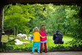 Kids Watching Animals In The Zoo Stock Images - 74930324