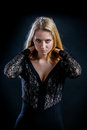 Blonde Girl On A Black Background In A Dark Guipure Dress Royalty Free Stock Images - 74931119