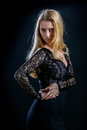 Blonde Girl On A Black Background In A Dark Guipure Dress Stock Photo - 74931340