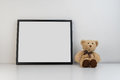 Mock Up Photo Frame On Table With A Teddy Bear As Decoration Royalty Free Stock Photos - 74950028