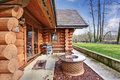 Large Log Cabin House Exterior With Patio Area. Royalty Free Stock Photo - 74955805