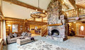 Bright Living Room Interior In American Log Cabin House. Royalty Free Stock Images - 74955959