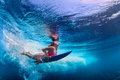 Beautiful Surfer Girl Diving Under Water With Surf Board Royalty Free Stock Photos - 74970878