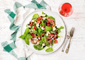 Summer Arugula, Prosciutto, Strawberry Salad With Glass Of Rose Wine Royalty Free Stock Photo - 75000365