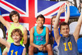 Happy British Supporters At The Tribune Royalty Free Stock Photography - 75001907