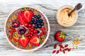 Acai Breakfast Superfoods Smoothies Bowl With Chia Seeds, Bee Pollen, Goji Berry Toppings And Peanut Butter. Overhead Stock Photos - 75011693