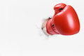 Hand In Boxing Glove Broke Through The Paper Wall Stock Images - 75012034