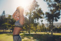 Fit Young Woman Getting Ready For Workout At The Park Royalty Free Stock Images - 75015029