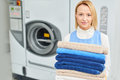 Portrait Of A Girl Laundry Worker Holding A Clean Towel Royalty Free Stock Photography - 75023167