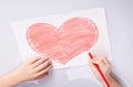 Childs Hands Drawing A Heart Stock Photography - 75039312