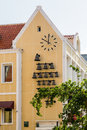 Bells And Clock On Yellow Curacao Church Stock Images - 75043394