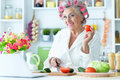 Senior Woman In  Hair Rollers At Kitchen Stock Photos - 75092233