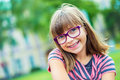 Girl. Teen. Pre Teen. Girl With Glasses. Girl With Teeth Braces. Young Cute Caucasian Blond Girl Wearing Teeth Braces And Glasses Royalty Free Stock Photography - 75095127