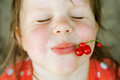Happy Child With Red Currants Stock Images - 75098614