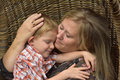 Cuddling With Day Nanny Stock Photo - 75100560