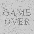Game Over Letters Carved On Stone Plate. Chips On Rock Royalty Free Stock Image - 75102026
