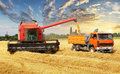 Overloading The Grain From The Combine Into A Car In The Field Royalty Free Stock Photography - 75120227