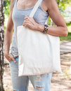 Woman Holding Empty Canvas Bag. Template Mock Up Royalty Free Stock Photo - 75124625