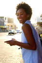 Cheerful African American Woman With Cell Phone Outdoors Royalty Free Stock Image - 75124926